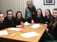 Kerry County Council Writer in Residence, Maire Holmes with Gaelcholáiste Chiarraí students at the poetry writing session to mark World Book Day in Kerry County Library were, from left: Jade Ni Bhriainmanns, Kayleigh Ni Fhinn, Tamzin Ni Bhriain, Mebhni Ni Mhaoldomhnaigh, Laoise Ni Dhulchaiontigh, Alana Eviston. Photo by Gavin O'Connor.