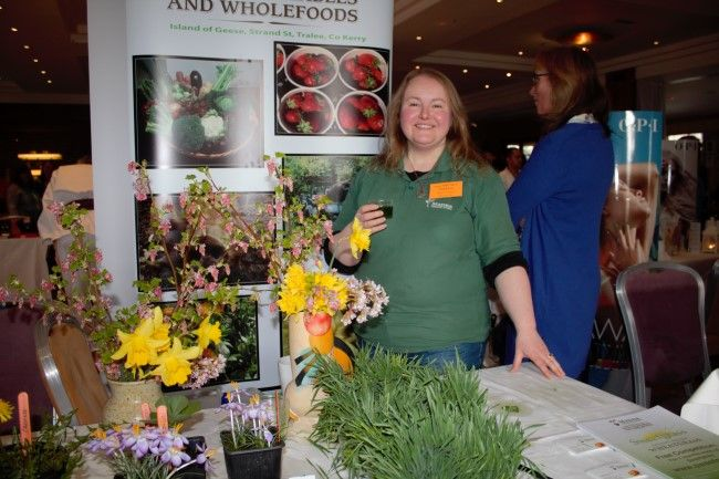 Claire O'Conner of Manna Organic Store at the fitness expo in the Fels Point Hotel on Saturday. Photo by Oscar Brophy