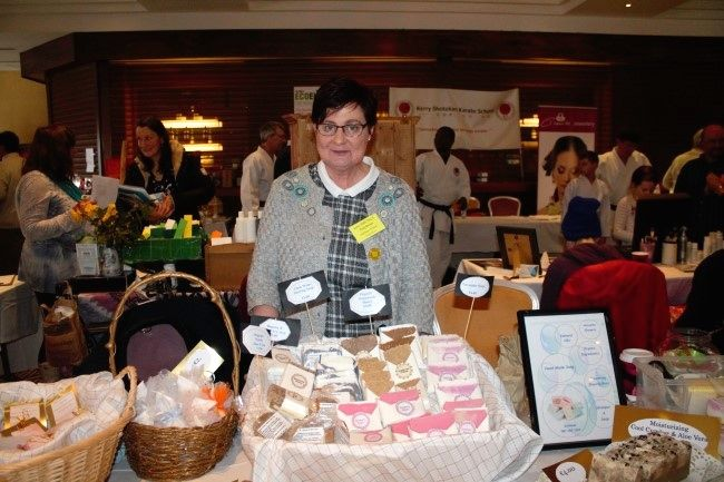 Kathleen O'Neil selling handmade soaps  at the fitness expo in the Fels Point Hotel on Saturday. Photo by Oscar Brophy