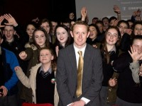 Colm Cooper with students of Gaelcholaiste Chiarraí at the Cinemobile at the Fels Point Hotel on Thursday. Photo by Oscar Brophy
