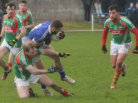 Kerins O'Rahilly's, Con Barrett gets in a hard challenge against St Micheal's Foilmore. Photo by Gavin O'Connor.