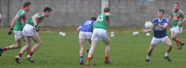 Cormac Coffey lays off a pass for Jack Savage. Photo bu Gavin O'Connor.