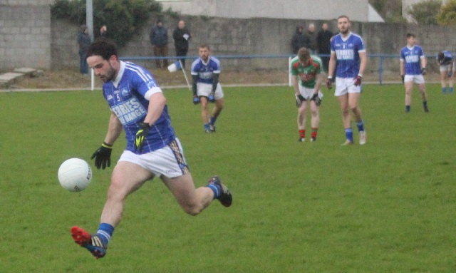 Cormac Coffey in full flight for Kerins O'Rahilly's. Photo by Gavin O'Connor.