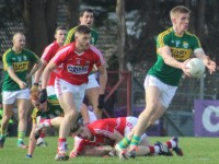 Tommy Walsh, looks to make a pass with Cork's Eoin Cadogan in hot pursuit. Photo by Gavin O'Connor.