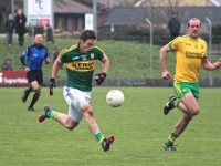 Stephen O'Brien in full flight under the close watch of Neil Gallagher. Photo by Dermot Crean.