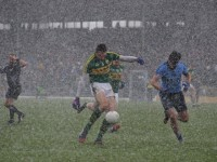 With hail stones teaming down, David Moran, grabs the game by the scruff of the neck and pings the ball over the bar for Kerry. Photo by Dermot Crean.