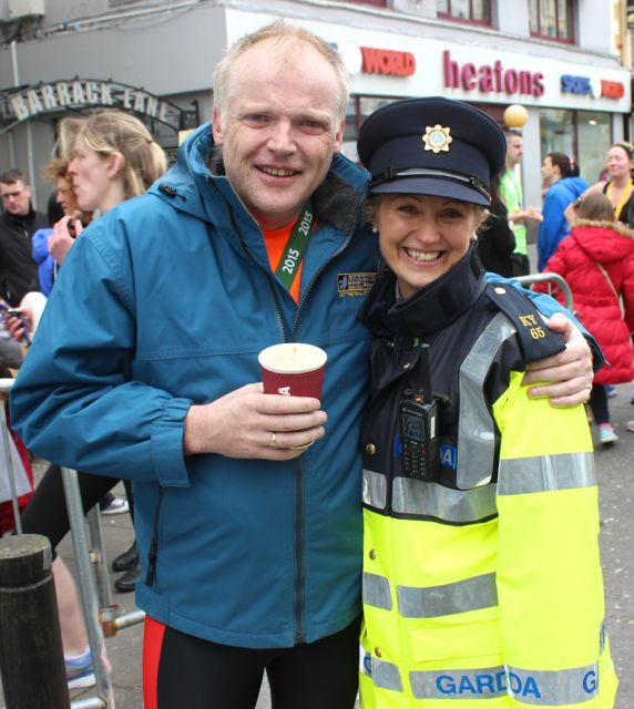 Kevin Finn and Sergeant Helena Carey at the Tralee Marathon finish line in The Mall on Sunday. Photo by Dermot Crean