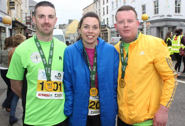 Colin Aherne, Lorraine Bowler and Tommy Leahy at the Tralee Marathon finish line in The Mall on Sunday. Photo by Dermot Crean