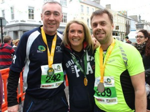 Maurice and Karen O'Carroll with Paul O'Sullivan at the Tralee Marathon finish line in The Mall on Sunday. Photo by Dermot Crean