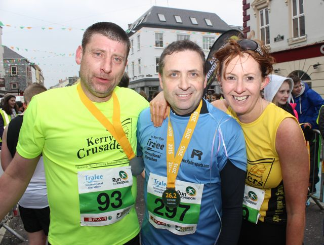 Eamonn Egan, Brendan Potter and Fiona Hehir at the Tralee Marathon finish line in The Mall on Sunday. Photo by Dermot Crean