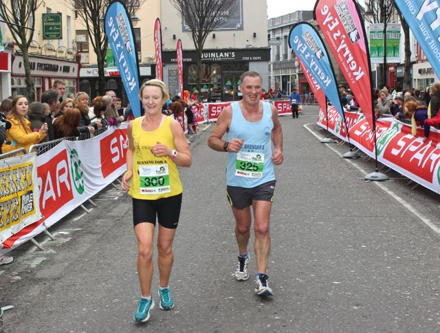 Cathy Quilter and Pat Sheehy at the Tralee Marathon finish line in The Mall on Sunday. Photo by Dermot Crean