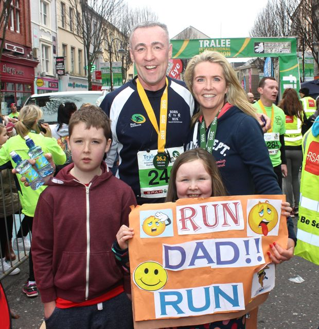 Maurice and Karen O'Carroll with children Tiernan and Naoise at the Tralee Marathon finish line in The Mall on Sunday. Photo by Dermot Crean