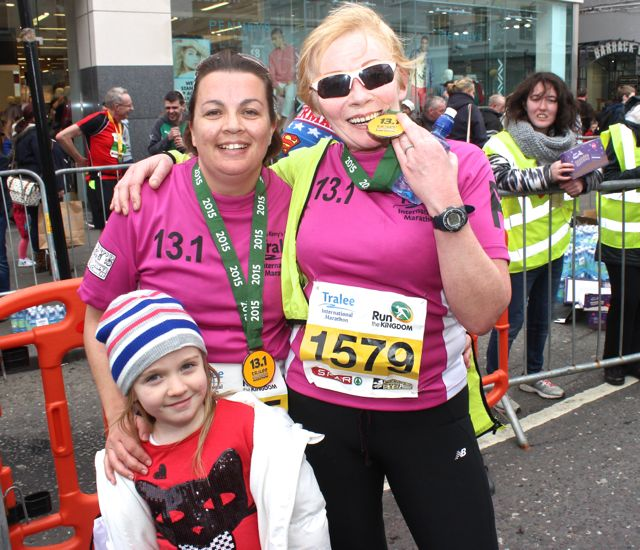 Grainne, Chloe and Catriona O'Sullivan at the Tralee Marathon finish line in The Mall on Sunday. Photo by Dermot Crean