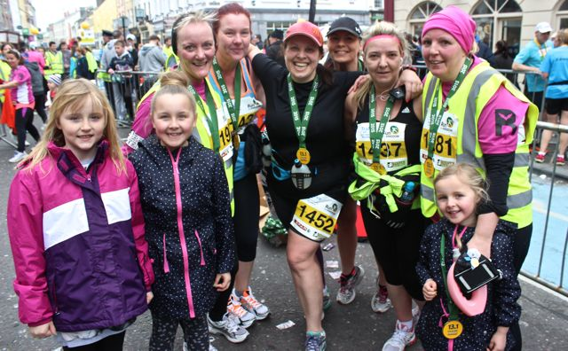 Keelin Coffey, Holly Leane, Jill Hannon, Donna O'Mahony, Ashley Keane O'Shea, Caroline McConnell, Kerry O'Mahony, Claire Leane and Taylor Kate Leane at the Tralee Marathon finish line in The Mall on Sunday. Photo by Dermot Crean