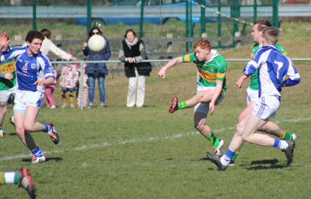 John Mitchels, Alan O'Donoghue, shoots for a score. Photo by Dermot Crean.