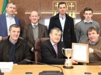 Terry O'Brien presents a memento to Ted Fitzgerald of the John Mitchels club in recognition of the Under 14 team's All-Ireland Féile win back in June. Also included are, in front; Dave Leahy. At back; Cllr Pa Daly (who proposed the team be recognised); Paul Barden, Diarmaid Cunnane and Mikey Kelliher. Photo by Dermot Crean