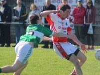 St Pat's, Sean Hayes, is tackled by Na Gaeil's, Darragh Sheehy. Photo by Gavin O'Connor.