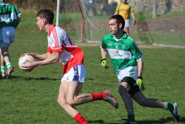 St Pat's, Willie Hurley, on the ball while Na Gaeil's, Ross Culloty attempts to shepherd him away from goal. Photo by Dermot Crean.