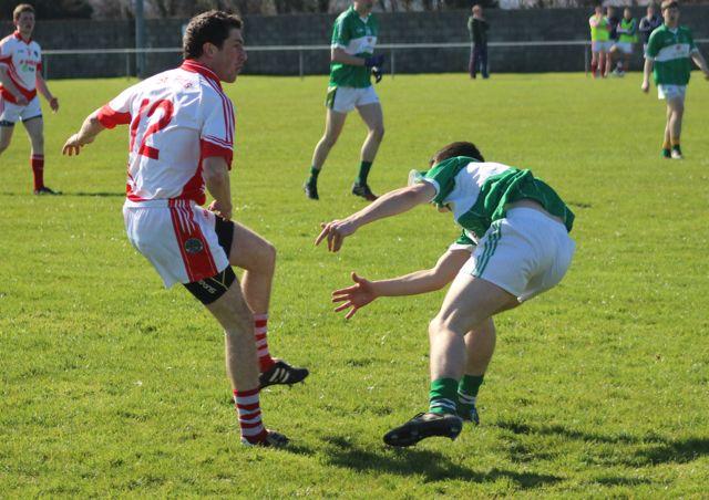 St Pat's, Kieran O'Donovon, gets a pass away against Na Gaeil. Photo by Gavin O'Connor.