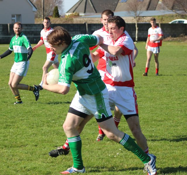 Na Gaeil's, Dan O'Connor attempts to drive at the St Pat's defence. Photo by Dermot Crean.