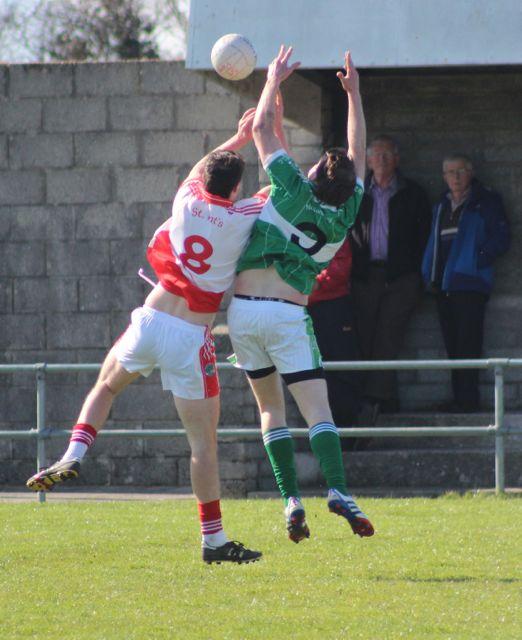 Na Gaeil's, Dan O'Connor and St Pat's, Micheal O'Sullivan, contest a kick out in midfield. Photo by Dermot Crean.