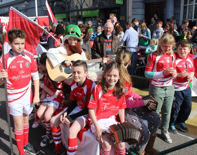 St Pat's GAA members get musical at the parade. Photo by Dermot Crean
