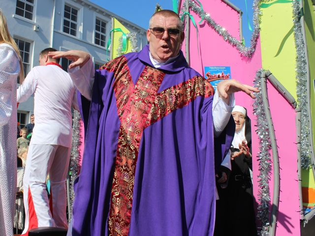 'Father' Tim Landers gets funky on the Tralee Musical Society float at the parade. Photo by Dermot Crean