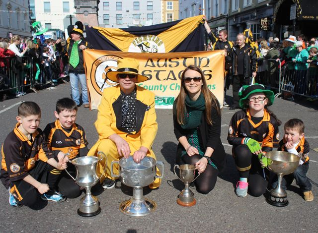 Members of the Austin Stacks show off the silverware at the parade. Photo by Dermot Crean