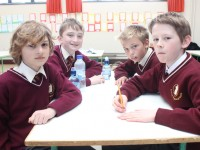 Holy Family pupils taking part in the Gaelscoil Mhic Easmainn table quiz as part of Seachtain Na Gaeilge were, from left: Martin Vladev, Ciaran Collins, Robert Vasiu and Cormac Lynch. Photo by Gavin O'Connor.