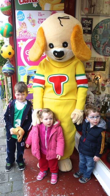 Darragh and Muireann Keane and James O'Riordan meet 'Toby' at Caballs Toymaster for the puppet show on Saturday morning as part of the Tír Na nÓg Festival. Photo by Dermot Crean