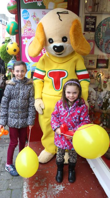 Caoimhe and Sarah O'Connor meet 'Toby' at Caballs Toymaster for the puppet show on Saturday morning as part of the Tír Na nÓg Festival. Photo by Dermot Crean