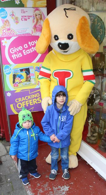 Ryan McCord and Matthew McDonagh meet 'Toby' at Caballs Toymaster for the puppet show on Saturday morning as part of the Tír Na nÓg Festival. Photo by Dermot Crean