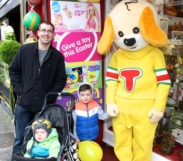 Kieran, Kyle and Ryan O'Flaherty meet 'Toby' at Caballs Toymaster for the puppet show on Saturday morning as part of the Tír Na nÓg Festival. Photo by Dermot Crean