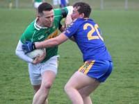 Stevie O'Mahony of John Mitchels struggles with a Spa Killarney player. Photo by Dermot Crean.