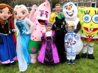 Two of the three winners of Fancy Dress Competition, Rachel O'Connor and Darragh Murphy with characters at the Meadowlands Hotel Kids Fun Run at the Town Park on Saturday afternoon as part of the Tír Na nÓg Festival. Photo by Dermot Crean