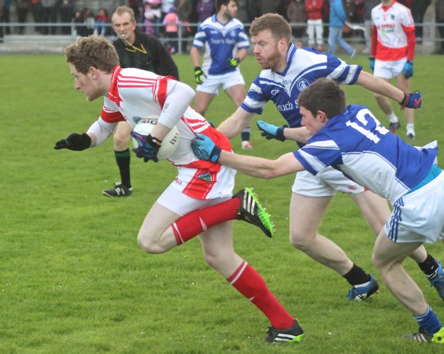 Liam O'Sullivan from St Pats in possession being chased by James Farrell & Kenneth Quirke of Annascaul. Photo by Dermot Crean.