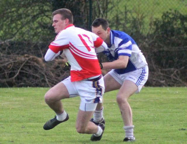 St Pats, Kieran Hurley is tackled by  Annascaul's Gerard O'Shea. Photo by Dermot Crean.