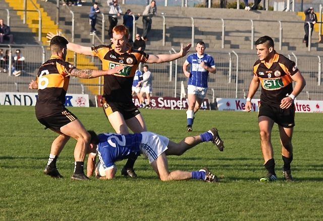 Austin Stacks, Shane O'Callaghan and Denis McElligott in action, with Wayne Guthrie in support. Photo by Adrienne McLaughlin.