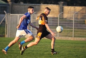 Sean Ryan, Austin Stacks shows a quick turn of foot, with John Ferguson of Kerins O'Rahillys in pursuit. Photo by Adrienne McLaughlin.