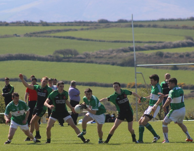 Na Gaeil's, Kieran Donovan, spots an opening, in shot, Churchill players, Brian Hall, Mikey Brennan and Cathal Rogers. Na Gaeil players, Mike Griffin, Ian McCarthy and David Culloty. Photo by Gavin O'Connor.