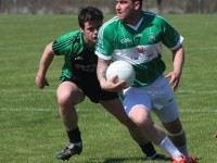 Na Gaeil's, David Culloty, looks for options while being shadowed by Churchill's Gareth Walsh. Photo by Gavin O'Connor.
