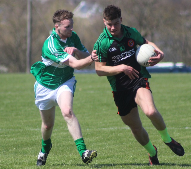 Churchill's, Ivan Parker, in possession with Na Gaeil's Stephen Fitzgerald attempting the challenge. Photo by Gavin O'Connor.
