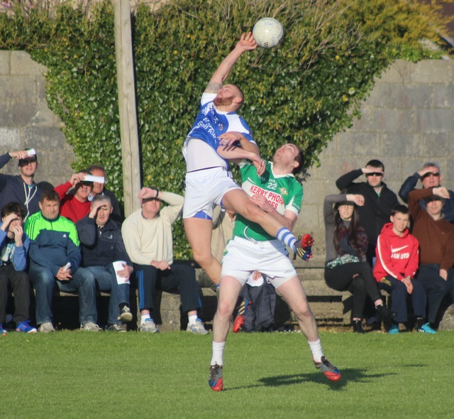 Barry John Keane, stretches out for a ball with Legions Kieran Slattery close by. Photo by Gavin O'Connor.