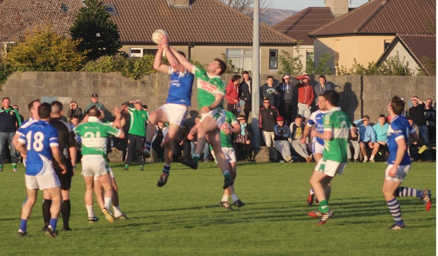 Tommy Walsh, rises high for the ball towards the end of the match. Photo by Gavin O'Connor.