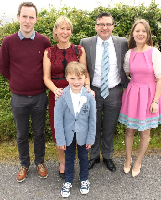 Fionn O'Brien from Blennerville NS who made his First Holy Communion on Saturday in St Brendan's Church Curraheen, with godfather David Doyle, parents Roisin and Shane and godmother Marguerite Dineen. Photo by Dermot Crean