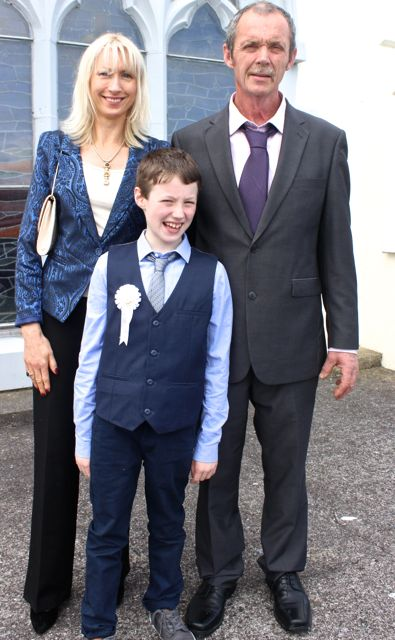 Eddie Stack from Blennerville NS who made his First Holy Communion on Saturday in St Brendan's Church Curraheen with parents Gerard and Martha. Photo by Dermot Crean