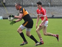 Austin Stacks, Kieran Donaghy on the ball while Dingle's Mark O'Connor keeps clse watch. Photo by Dermot Crean.