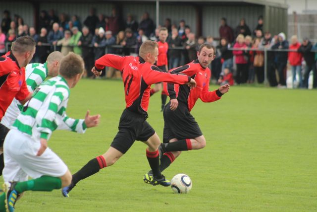Gintaras Paketuras, attacks the Carrick United defence. Photo by Dermot Crean.