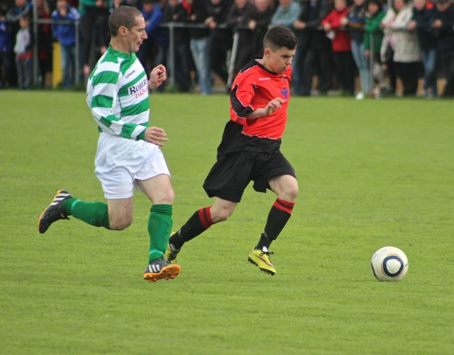 Tralee Dynamos, Danny Roche, takes on the Carrick United, defence. Photo by Dermot Crean.