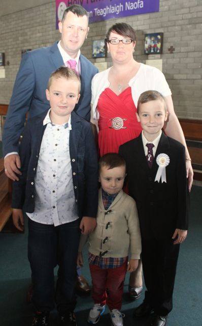 Jonathan Moriarty of Holy Family NS who made his First Holy Communion on Saturday in Our Lady and St Brendan's Church, pictured with his family John, Freda, Dylan and Adam. Photo by Dermot Crean